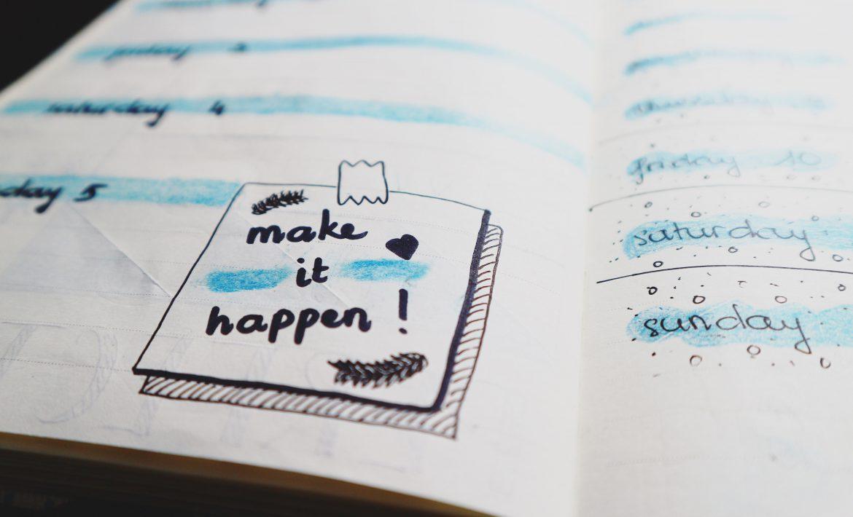 open notebook with make it happen written inside