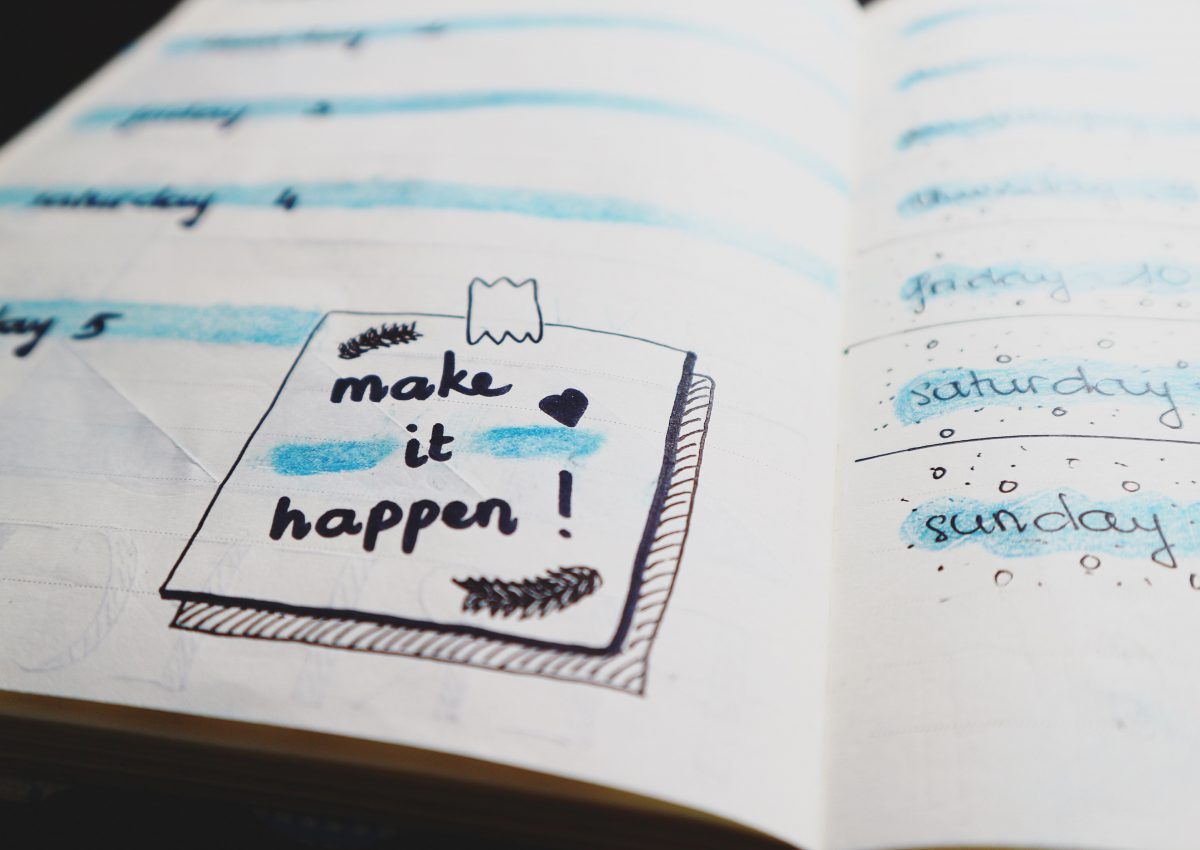 open notebook with make it happen written inside