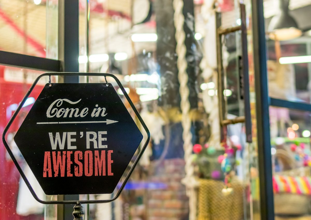 Sign pointing customers inside for business growth